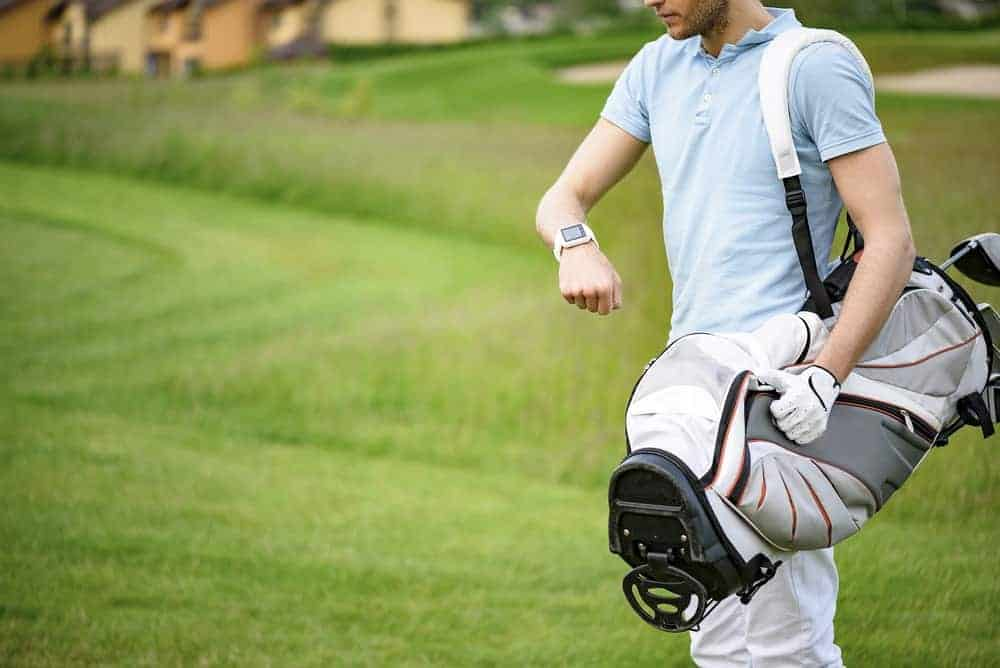 Golfer looking at his smartwatch.