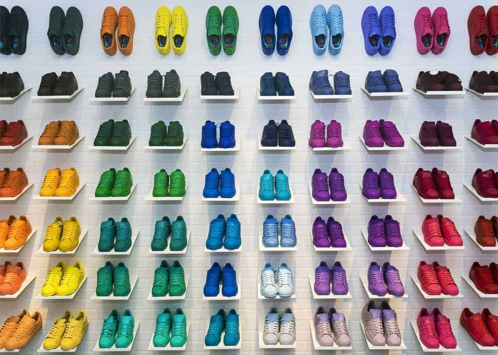 Rainbow colored Adidas sneakers.