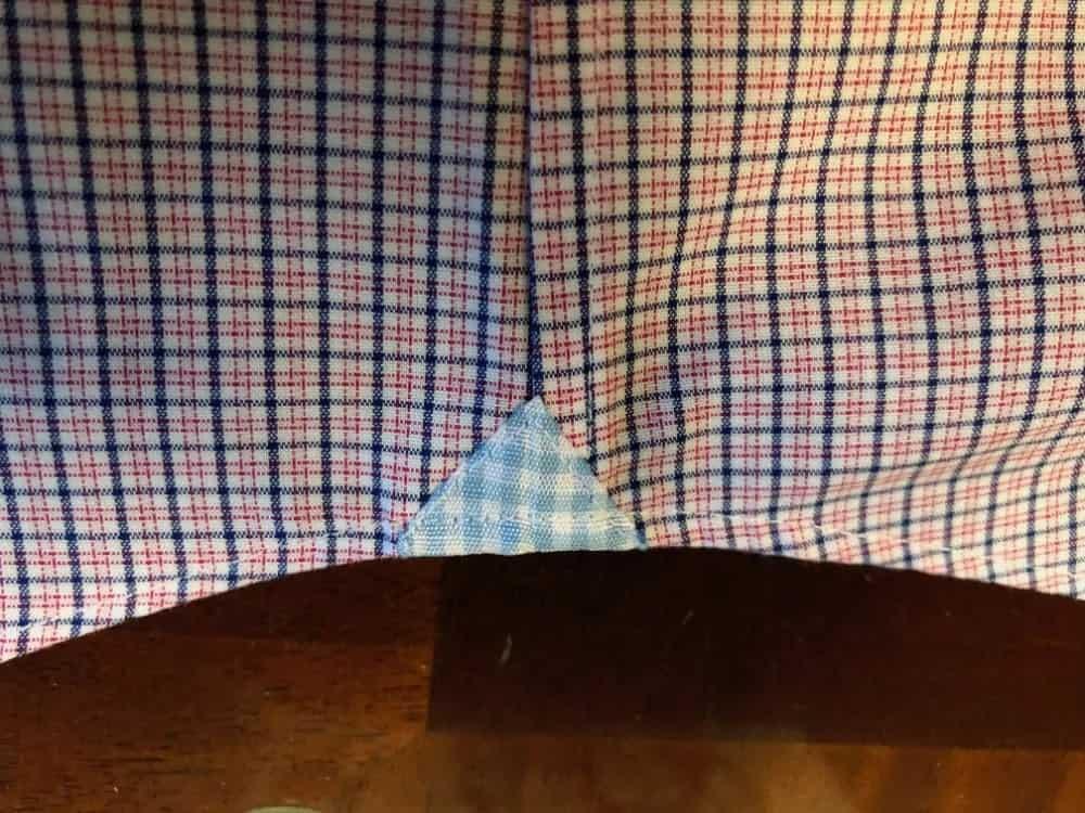 Close-up photo of the bottom side seam for Banana Republic men's slim fit dress shirt.