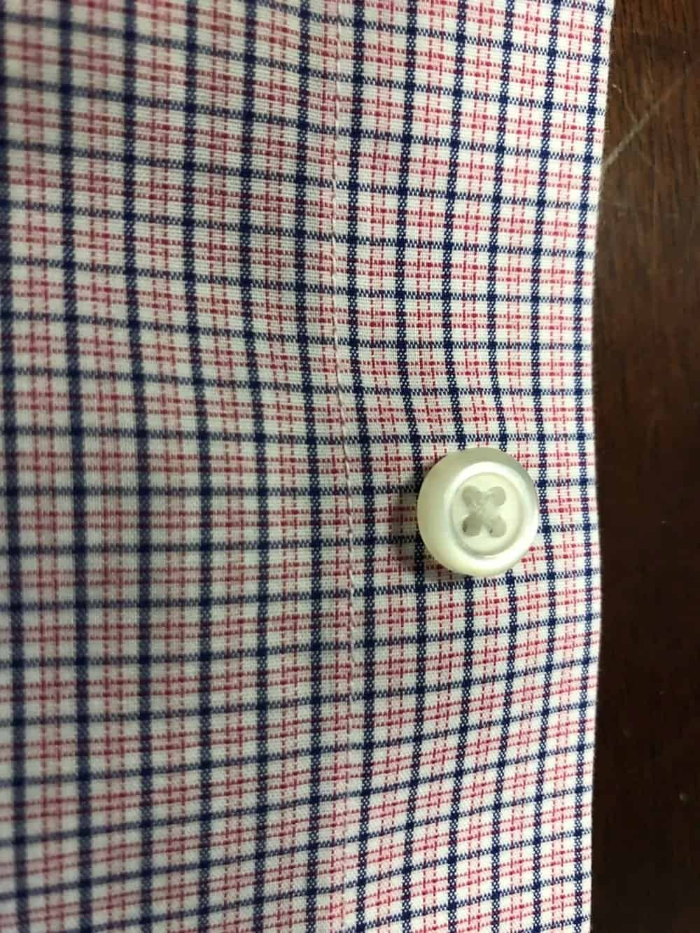Close up photo of the buttons used on Banana Republic men's slim fit non-iron dress shirt.