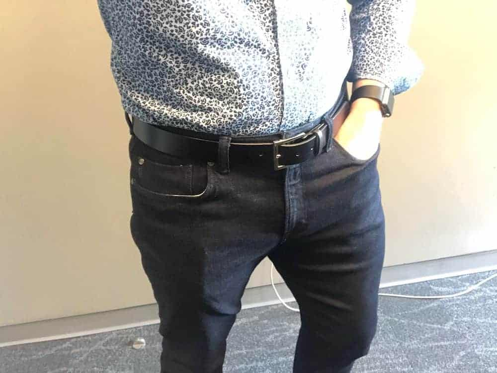 Close up Banana Republic Traveler jeans for men - front view and dark blue.