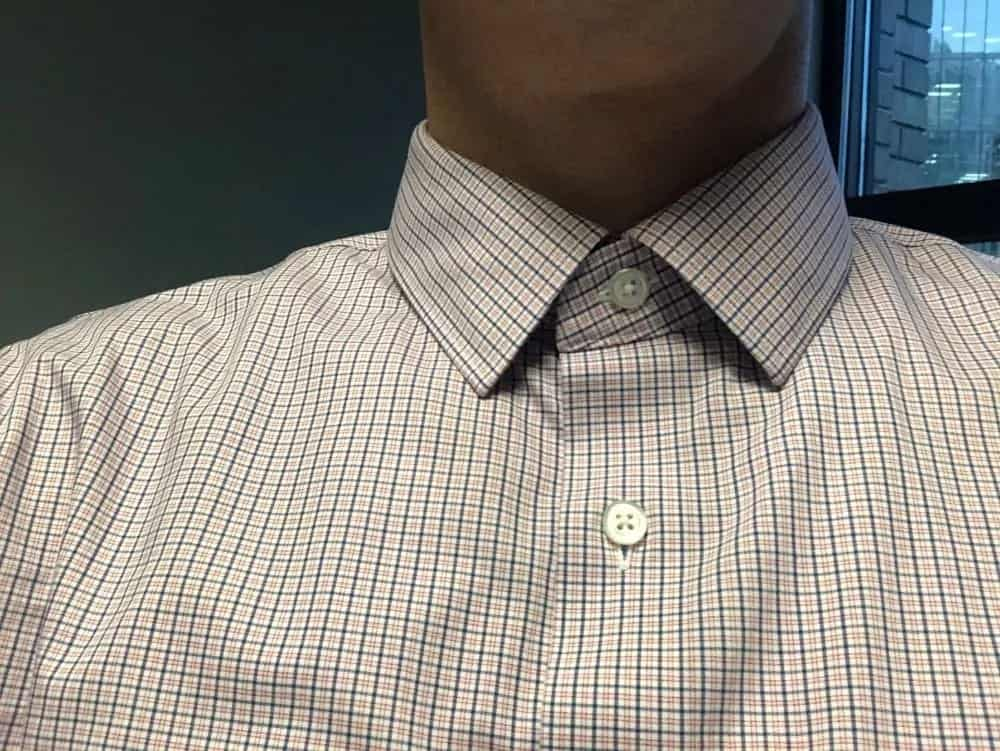 Standard collar style. Neither spread nor pointed. The collar is kept stiff with plastic strips.