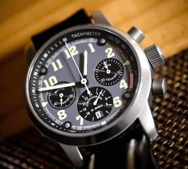 A close look at a man's chronograph-style watch.