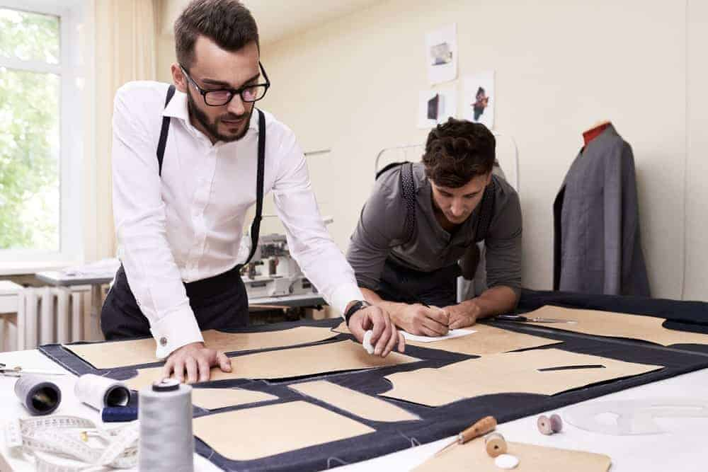 Two young men working on a pattern maker.