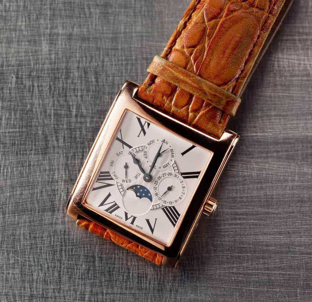 A close look at a square-shaped watch for men.