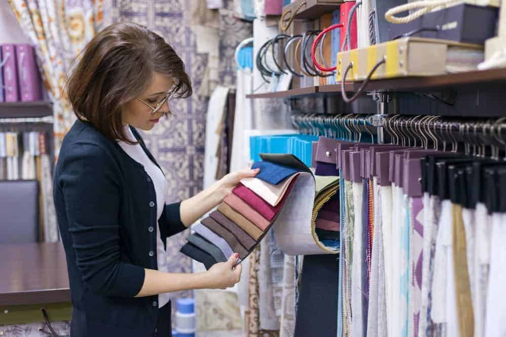 Woman scanning different textiles colors.