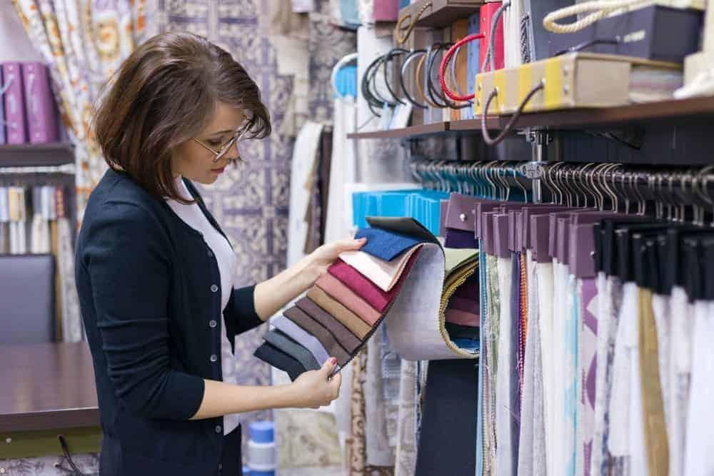 Woman scanning different textiles colors.