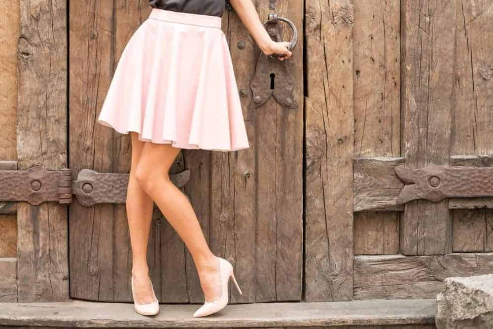 legs pretty open with skirt girl