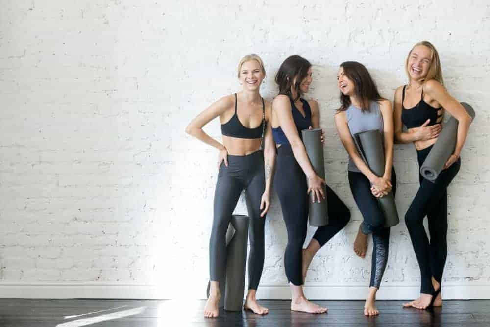 A group of women wearing work-out clothing.