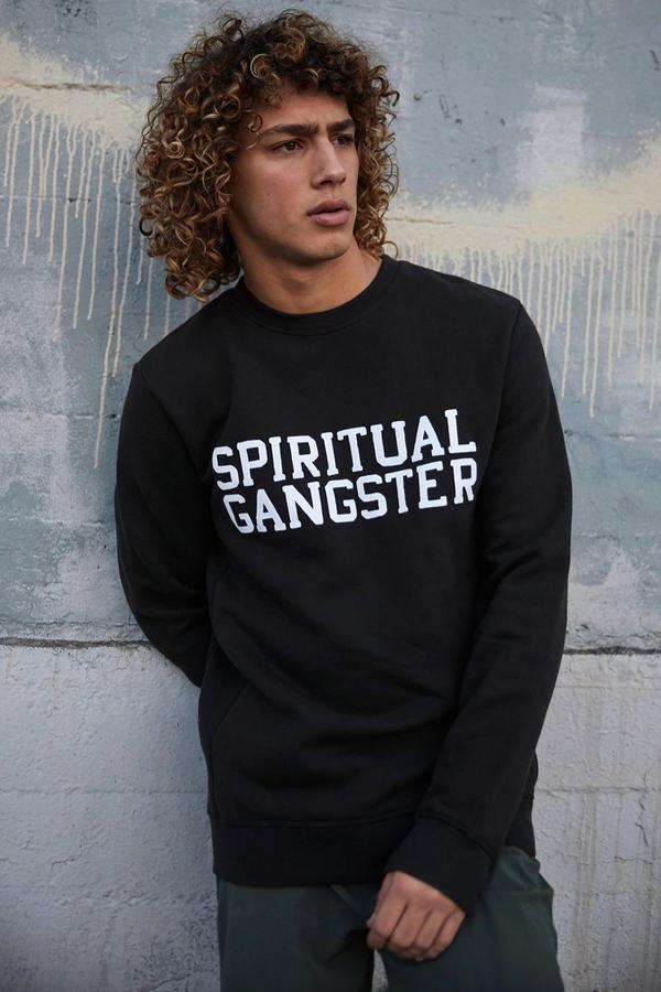 man modelling Spiritual Gangster Clothing.