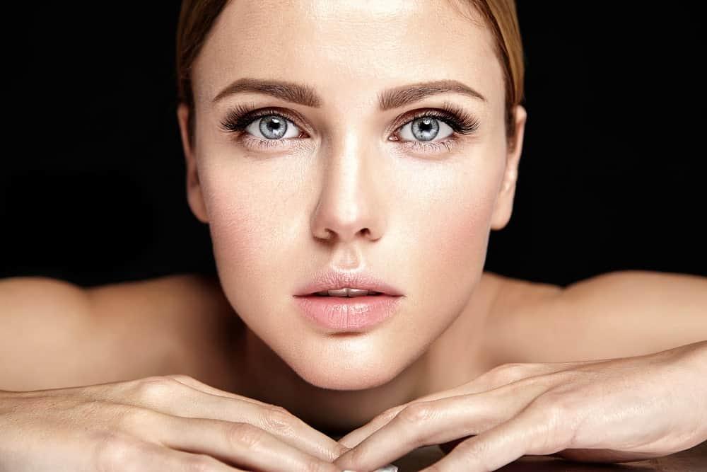 A close look at a woman with no makeup.