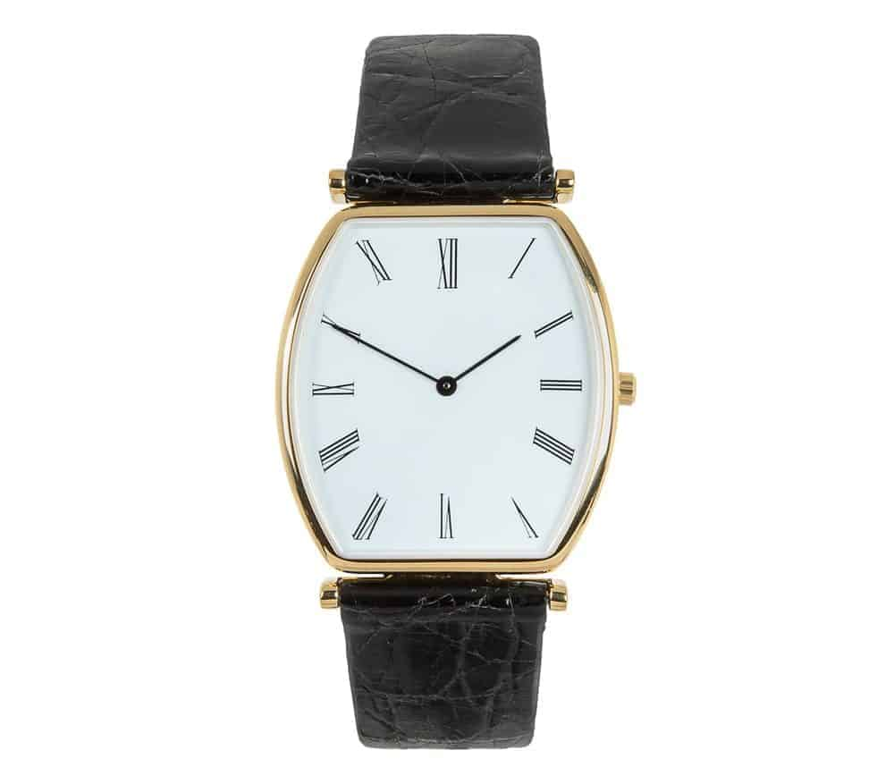 Analog watch with black leather strap.
