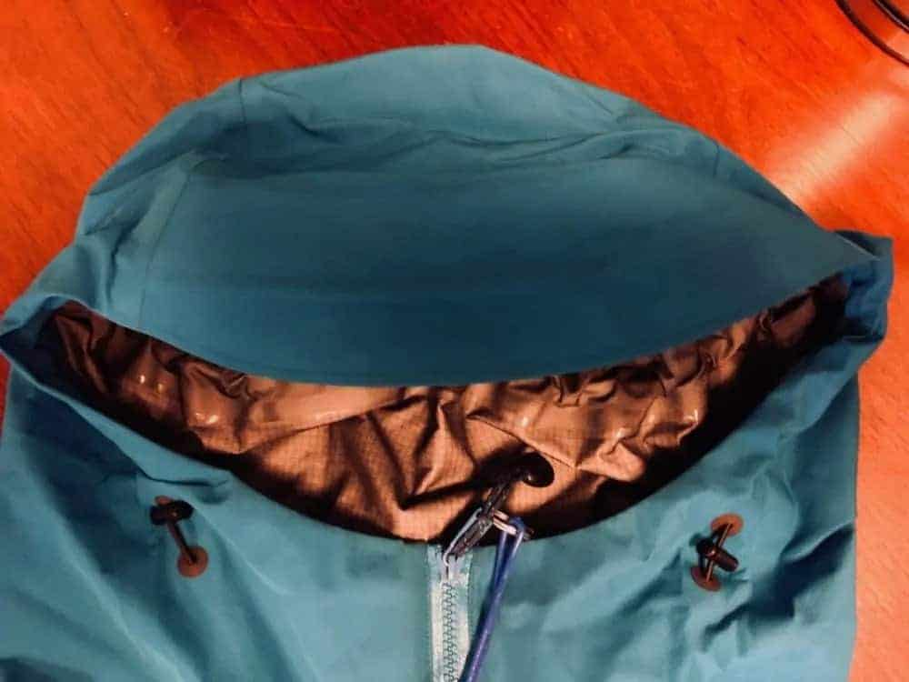 Front view of hood of Arc'Teryx Beta LT jacket. Hood adjustments to left and right of zipper.