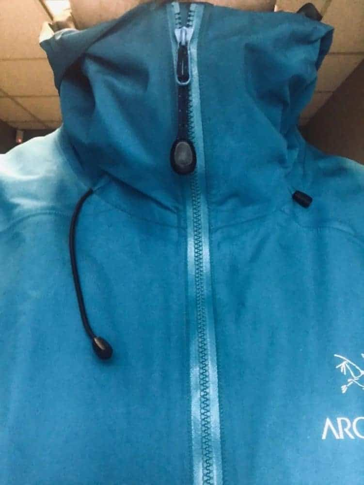 Close-up front view of zipped up Arc'Teryx Beta LT jacket. Notice the extensive neck protection when zipped up.
