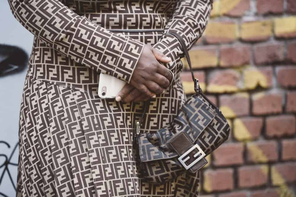 Woman in a Fendi outfit with matching bag.