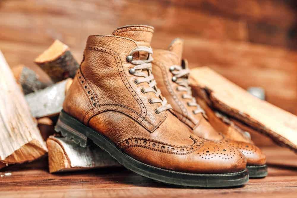 Balmoral boots on tree blocks and hardwood floor.