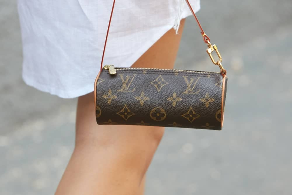 Woman with small Louis Vuitton barrel bag.