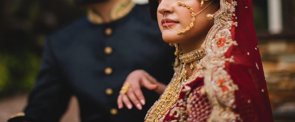 Pakistani Indian bride wearing nose ring.