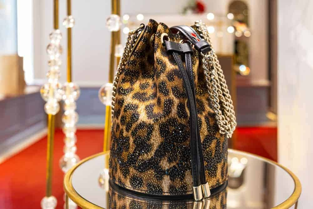 Leopard bucket bag at Louboutin store.