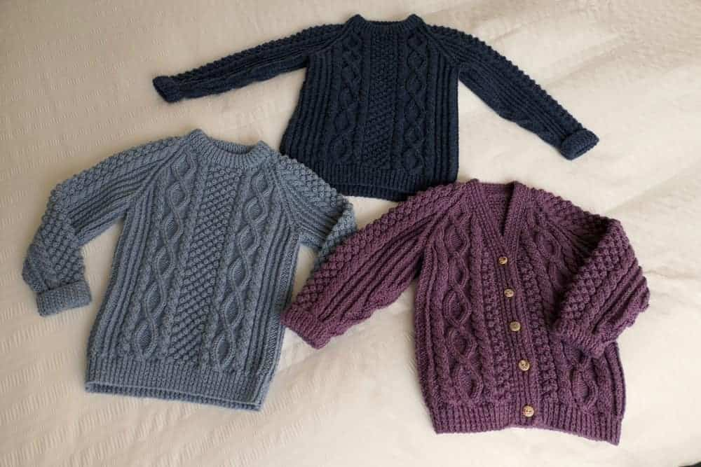 Multicolored cable knit sweaters