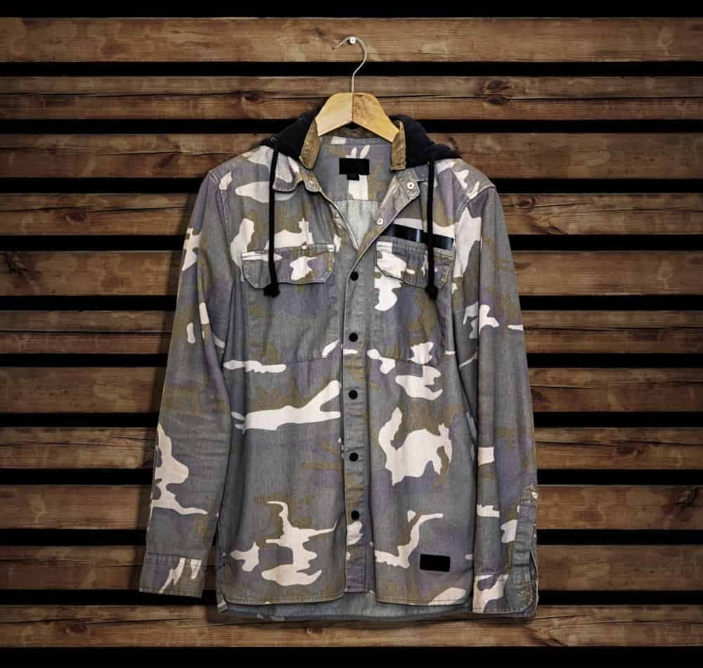 Closer look at a hanged gray camouflage shirt.