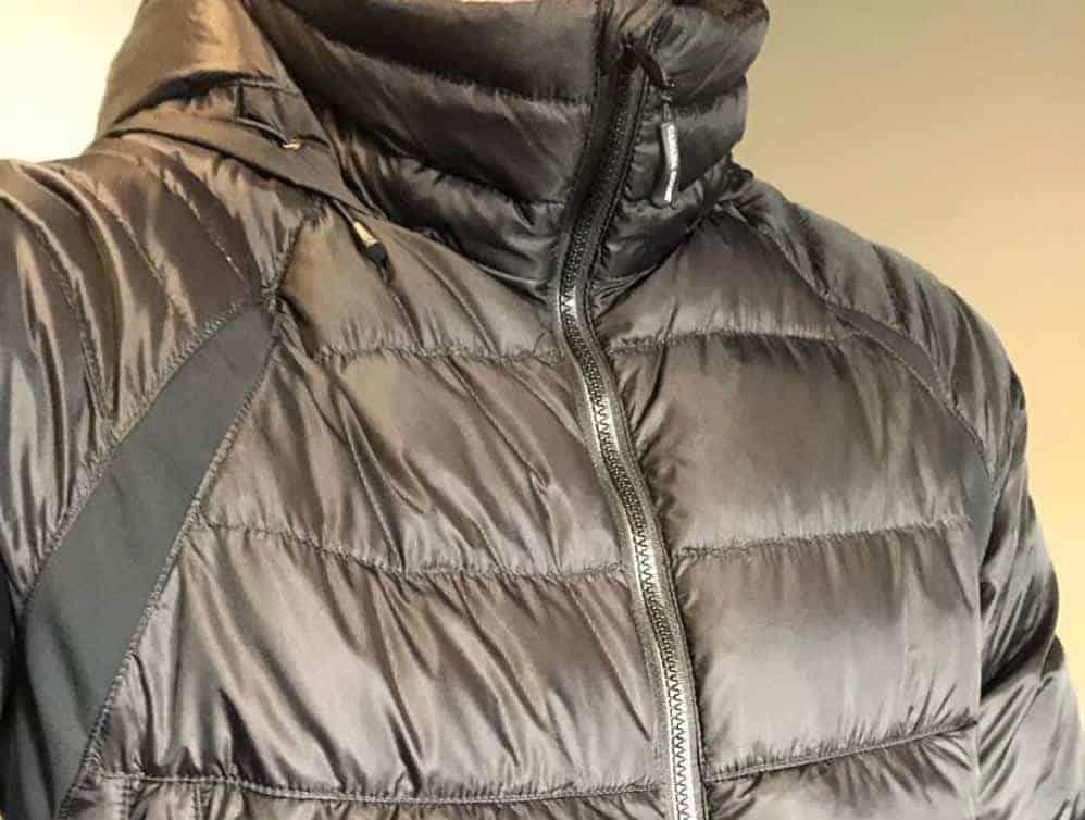 A close look at a black zipped-up Canada Goose jacket.