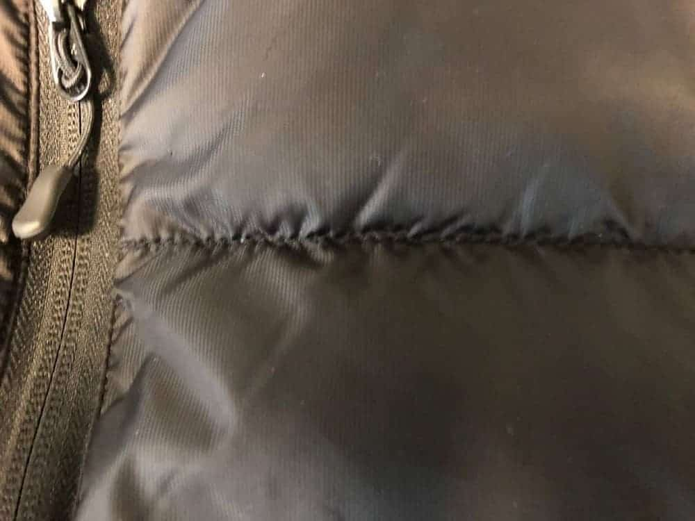 Close up of stitching on Canada Goose puffer down jacket.