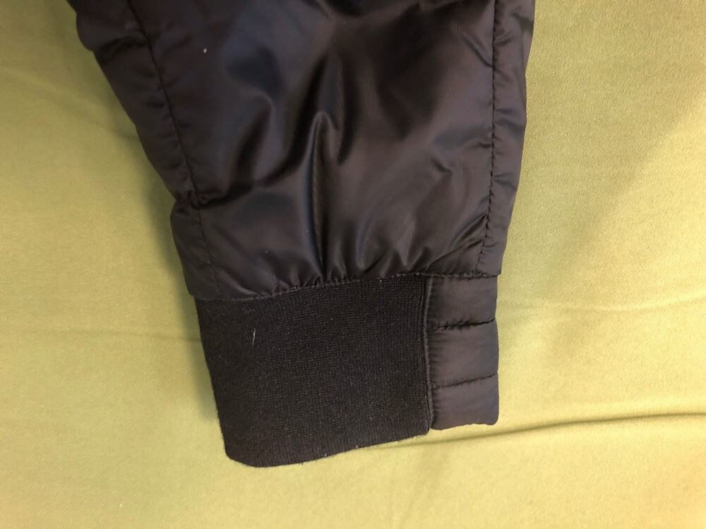 Close up of cuff on Canada Goose puffer jacket.