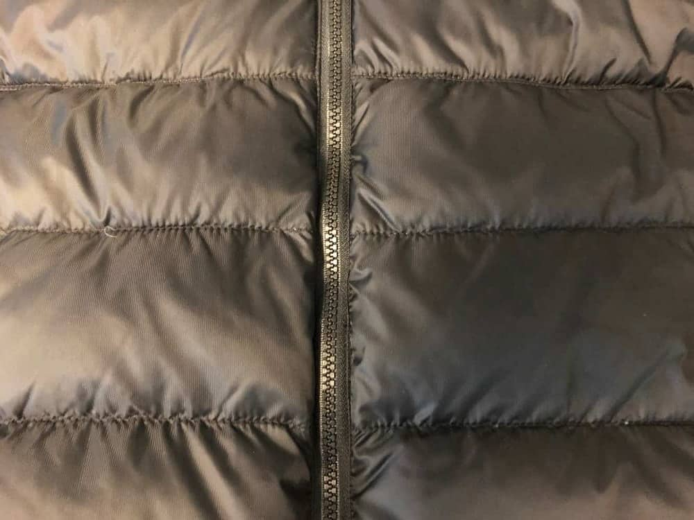 Close up of Canada Goose jacket stitching and zipper.