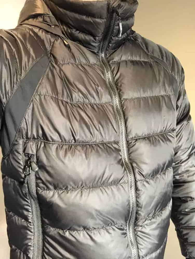Wearing a black Canada Goose down jacket.