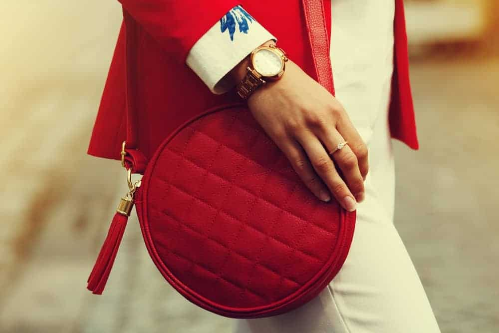 Woman with red quilted leather handbag.