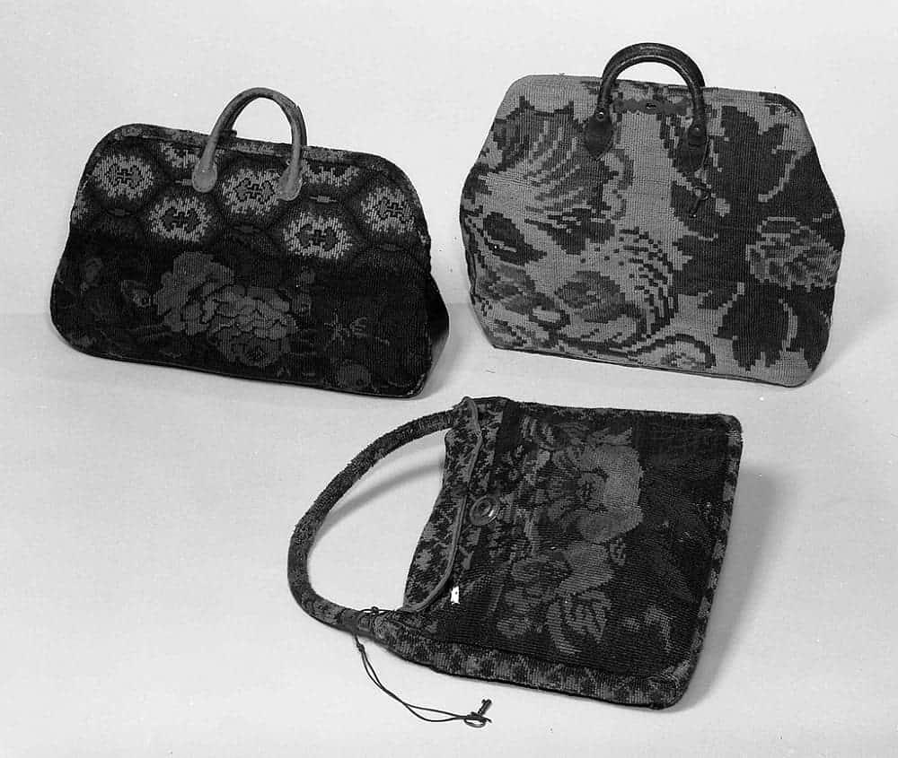 Black carpet bags