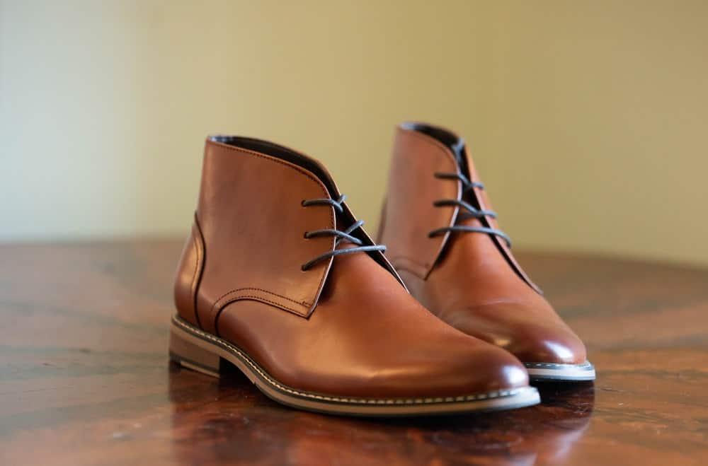 Italian chukka boots over the hardwood floor.