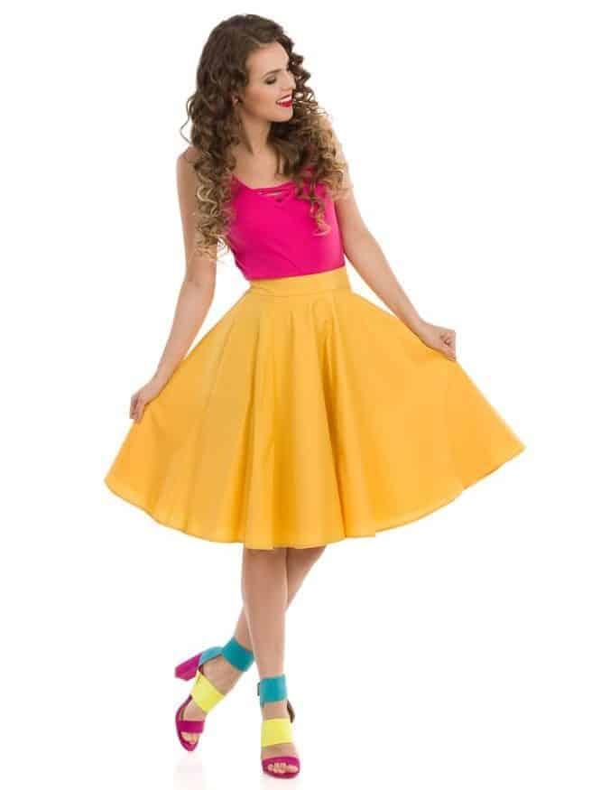 Woman presenting her circle cut yellow skirt.
