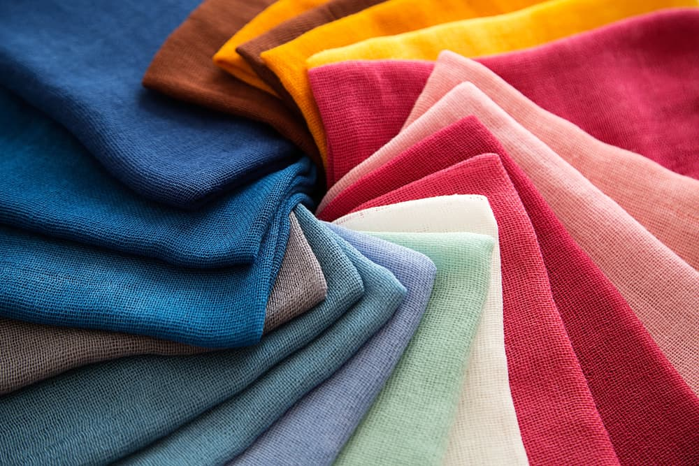 A group of twisted colored fabrics