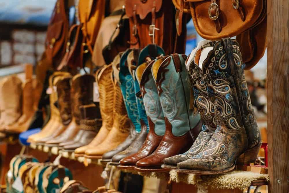 Cowboy boots displayed on a shelf.