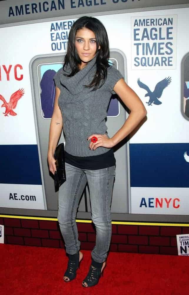 Jessica Szohr wearing a cowl neck sweater.