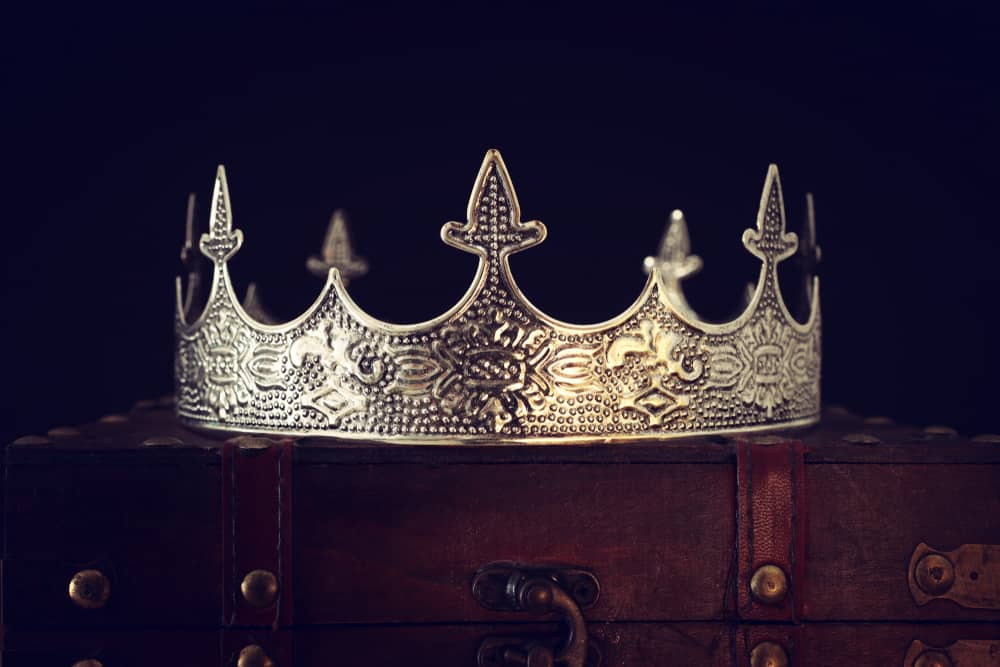 Vintage crown on a wooden chest.