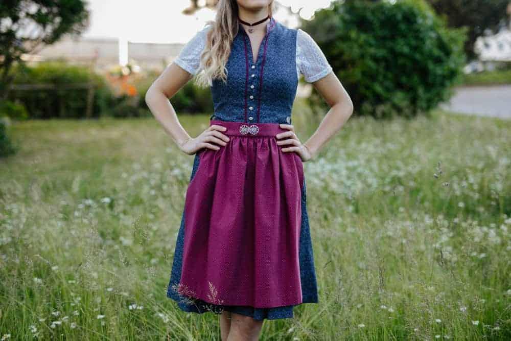 Woman wearing a dirndl skirt.
