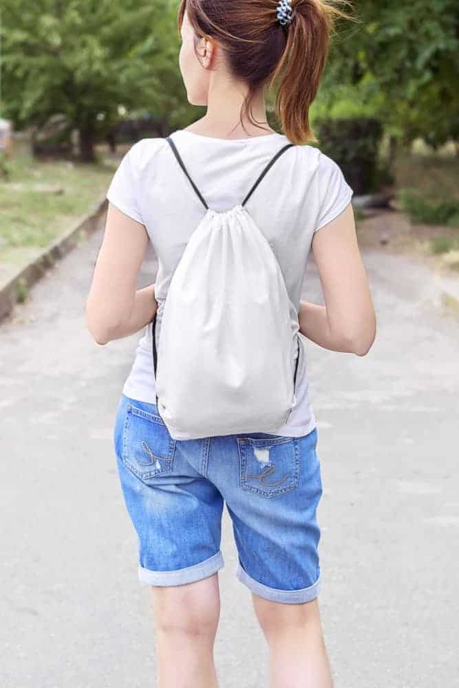 Woman with drawstring bag.