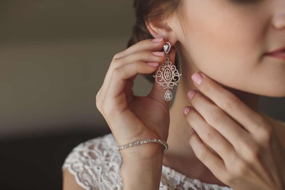 Bride wearing a dangling earring.