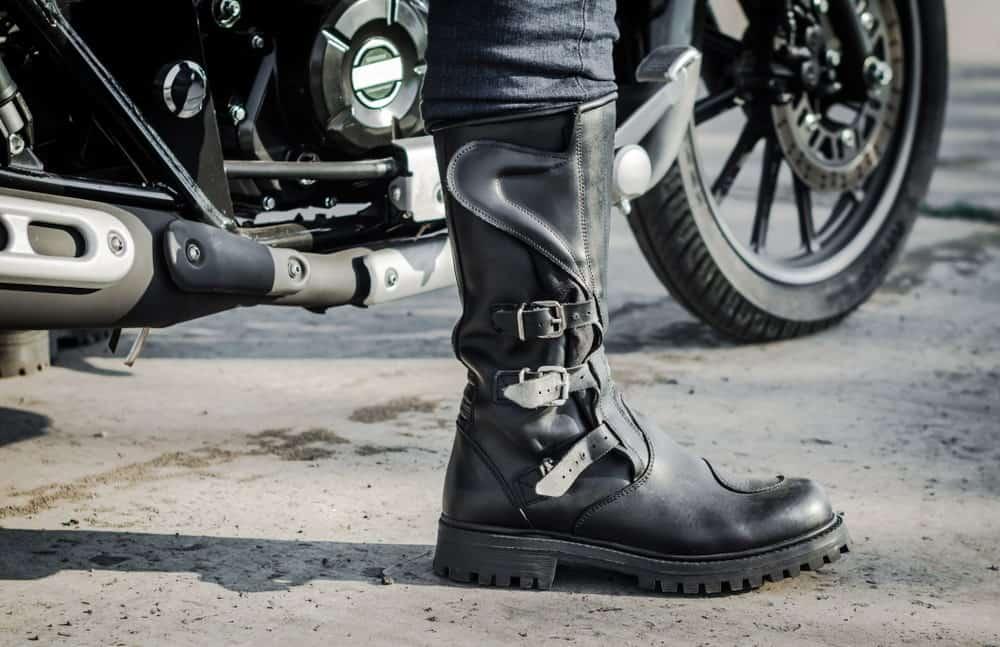 A man on a bike wearing an engineer boot.