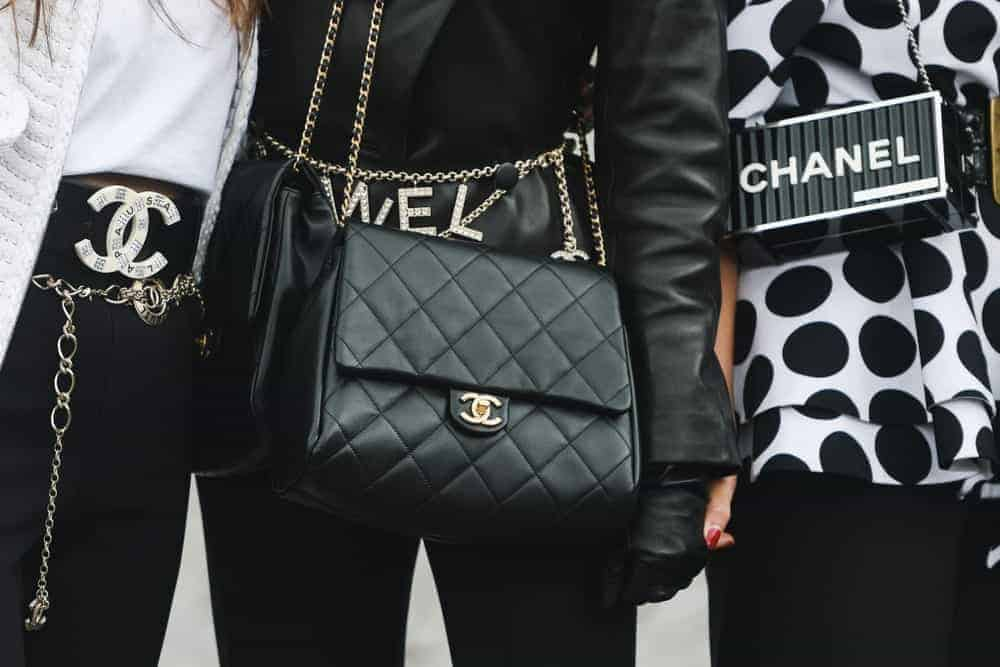 Women wearing Chanel purses.