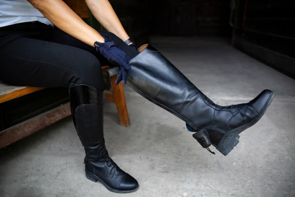 An equestrian wearing gumboots.