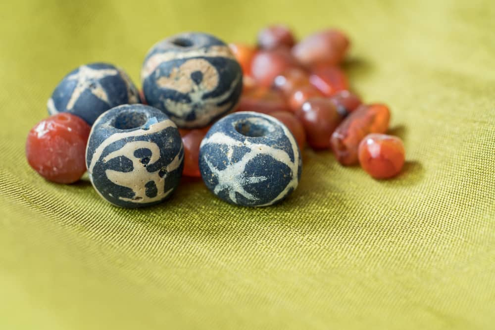 Ancient blue bird glass beads along with ancient carnelian beads.