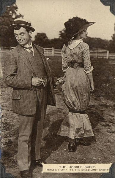 Man pointing his thumb on a woman wearing a hobble skirt.
