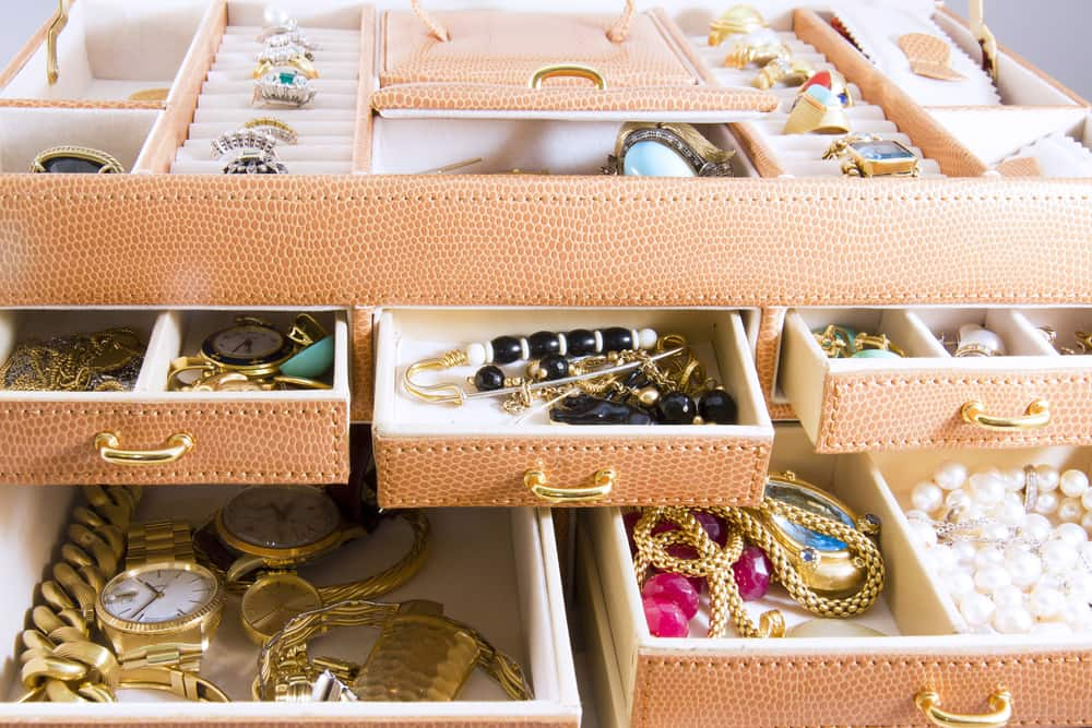 Various jewelry in jewelry boxes.
