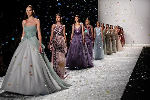 Models flaunting their layered dresses on the runway.