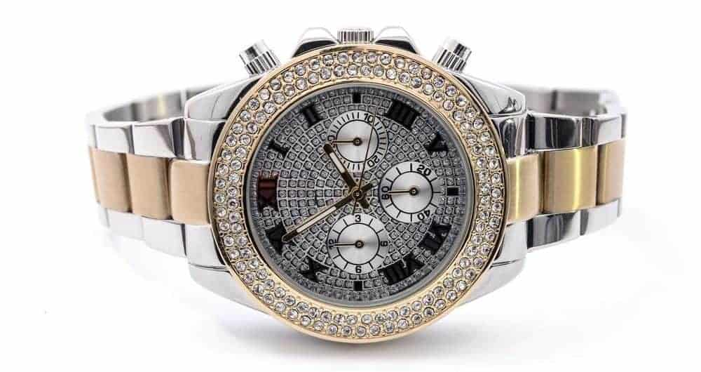 Luxury watch in two tone with diamond bezel.