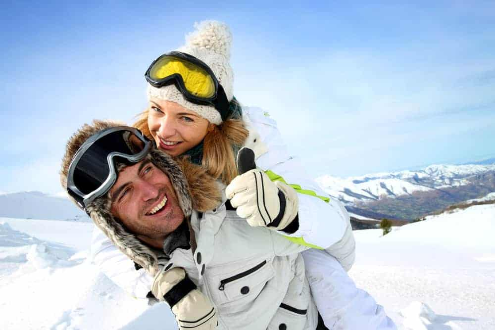 Man and woman wearing gloves in snow